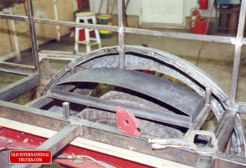 "Building the rear wheel wells <div class=""download-image""><a href=""https://oldinternationaltrucks.com/wp-content/uploads/2017/09/124.jpg"" download><i class=""fa fa-download""></i> <span class=""full-size""></span></a></div>"