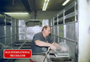 "George Kirkham finishing the rear wheel wells <div class=""download-image""><a href=""https://oldinternationaltrucks.com/wp-content/uploads/2017/09/149.jpg"" download><i class=""fa fa-download""></i> <span class=""full-size""></span></a></div>"