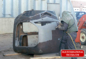 "Cab being sand blasted to remove years of rust and old paint. <div class=""download-image""><a href=""https://oldinternationaltrucks.com/wp-content/uploads/2017/09/28-2.jpg"" download><i class=""fa fa-download""></i> <span class=""full-size""></span></a></div>"