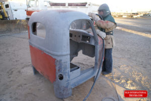 "Cab being sand blasted to remove paint and rust <div class=""download-image""><a href=""https://oldinternationaltrucks.com/wp-content/uploads/2017/09/DSC04381.jpg"" download><i class=""fa fa-download""></i> <span class=""full-size""></span></a></div>"