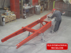 "International red being sprayed on the frame <div class=""download-image""><a href=""https://oldinternationaltrucks.com/wp-content/uploads/2017/09/DSCN7008.jpg"" download><i class=""fa fa-download""></i> <span class=""full-size""></span></a></div>"