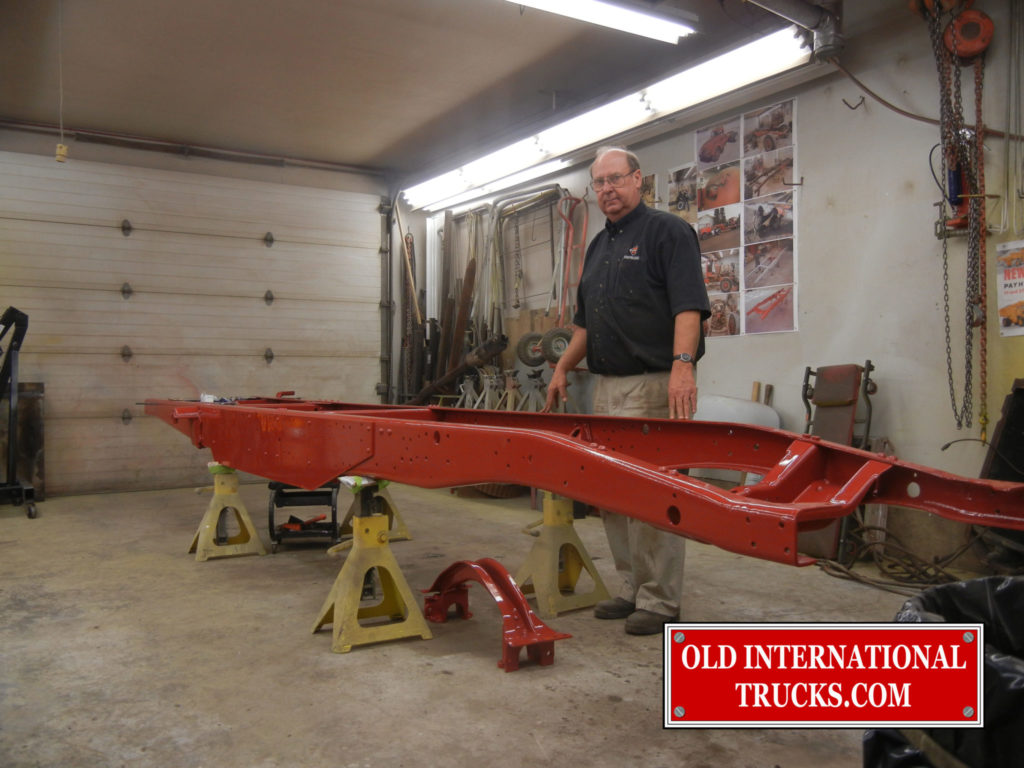 """George Kirkham with the frame ready to start putting it back together <div class=""""download-image""""><a href=""""https://oldinternationaltrucks.com/wp-content/uploads/2017/09/DSCN7131.jpg"""" download><i class=""""fa fa-download""""></i> <span class=""""full-size""""></span></a></div>"""