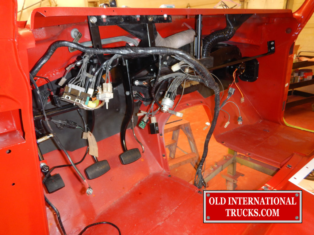 "a N.O.S. wire harness being installed.  <div class=""download-image""><a href=""https://oldinternationaltrucks.com/wp-content/uploads/2017/09/DSCN7662.jpg"" download><i class=""fa fa-download""></i> <span class=""full-size""></span></a></div>"