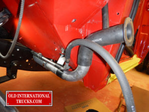 "Left fuel tank filler hoses being put in place <div class=""download-image""><a href=""https://oldinternationaltrucks.com/wp-content/uploads/2017/09/DSCN8353_1.jpg"" download><i class=""fa fa-download""></i> <span class=""full-size""></span></a></div>"