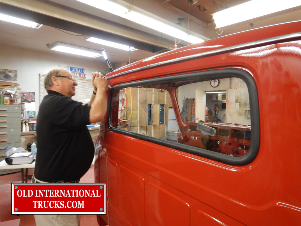 "George Kirkham installing the rear window. <div class=""download-image""><a href=""https://oldinternationaltrucks.com/wp-content/uploads/2017/09/DSCN9761_1.jpg"" download><i class=""fa fa-download""></i> <span class=""full-size""></span></a></div>"