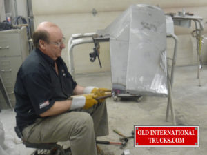"George doing some metal work an front fenders <div class=""download-image""><a href=""https://oldinternationaltrucks.com/wp-content/uploads/2017/09/P1040008.jpg"" download><i class=""fa fa-download""></i> <span class=""full-size""></span></a></div>"