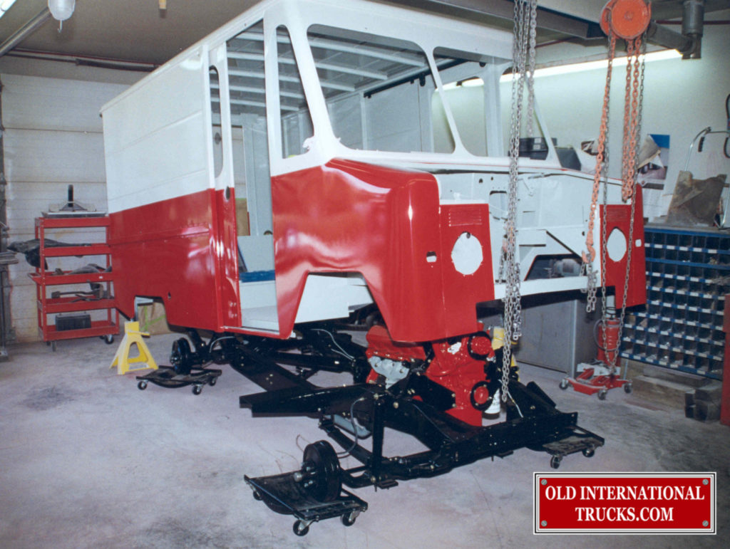 """SLIDING THE CHASSIS UNDER THE BODY. <div class=""""download-image""""><a href=""""https://oldinternationaltrucks.com/wp-content/uploads/2017/11/54.jpg"""" download><i class=""""fa fa-download""""></i> <span class=""""full-size""""></span></a></div>"""