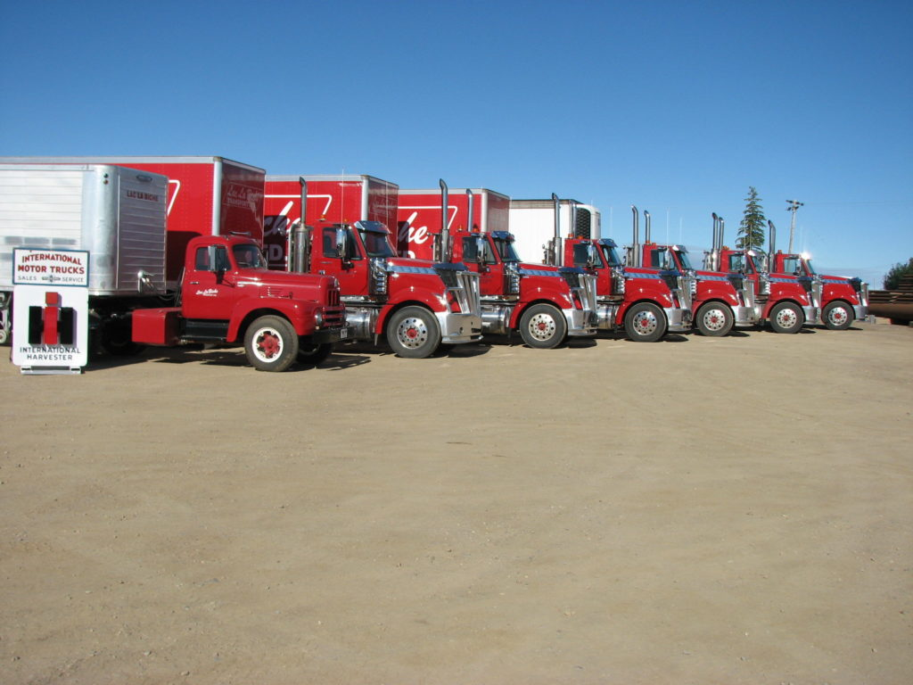 "Lac La Biche Transport fleet of trucks old and new <div class=""download-image""><a href=""https://oldinternationaltrucks.com/wp-content/uploads/2018/01/Lac-La-Biche-.jpg"" download><i class=""fa fa-download""></i> <span class=""full-size""></span></a></div>"