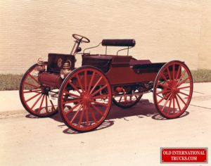"""1909 Early Auto Wagon <div class=""""download-image""""><a href=""""https://oldinternationaltrucks.com/wp-content/uploads/2021/03/1909-Early-Auto-Wagon.jpg"""" download><i class=""""fa fa-download""""></i> <span class=""""full-size""""></span></a></div>"""