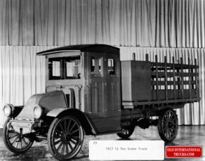 """1917 1 and Half ton Stake Truck <div class=""""download-image""""><a href=""""https://oldinternationaltrucks.com/wp-content/uploads/2021/03/1917-1-and-Half-ton-Stake-Truck.jpg"""" download><i class=""""fa fa-download""""></i> <span class=""""full-size""""></span></a></div>"""